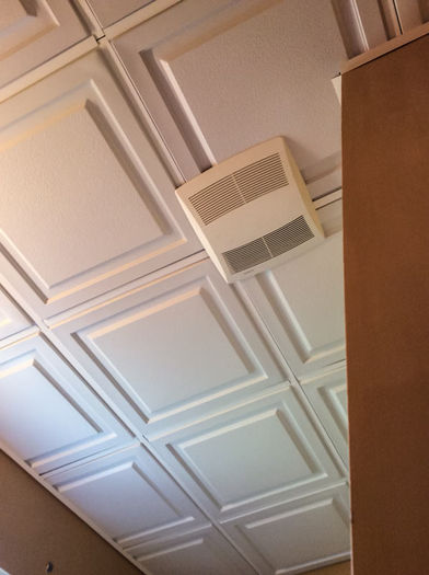 Installation of 2x2 White Ceiling Tiles