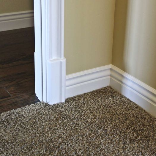 Installed white baseboard molding