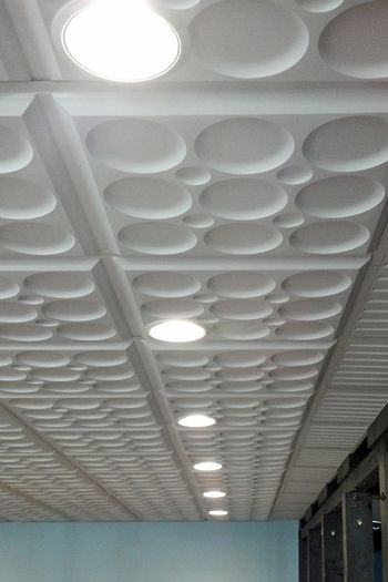 White Roman Circle Ceiling Tile in a Grid