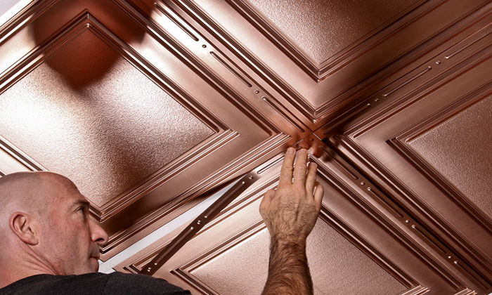 Installing faux copper decorative grid strips to the grid with Faux Copper Stratford tiles