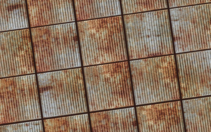 Old Tin Roof Ceiling Tile in a Ceiling Grid