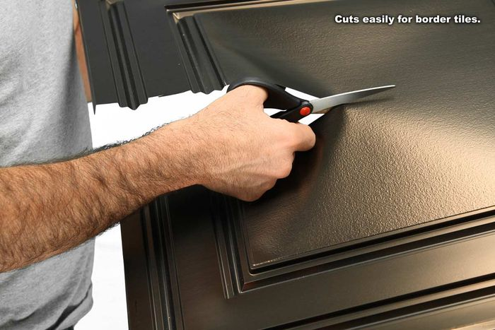 Cutting a Stratford Bronze Ceiling Tile with Scissors