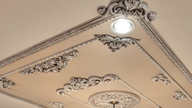 Decorative moldings and accents installed on ceiling