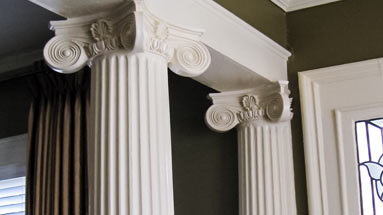 Decorative columns around support beam